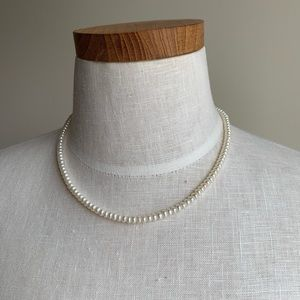 Natural string of pearls with 14k gold hardware